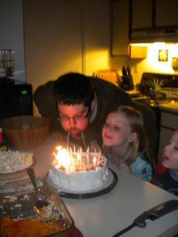 The day before, blowing out candles with our little Plesics.